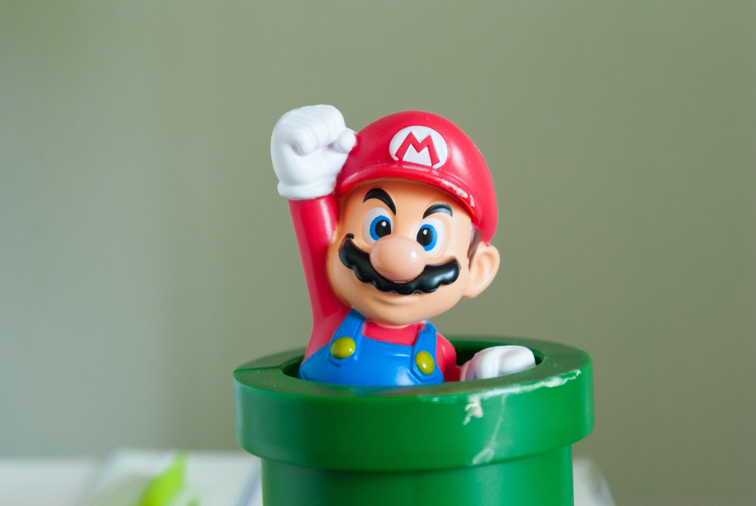 mario from super mario coming out of a warp pipe