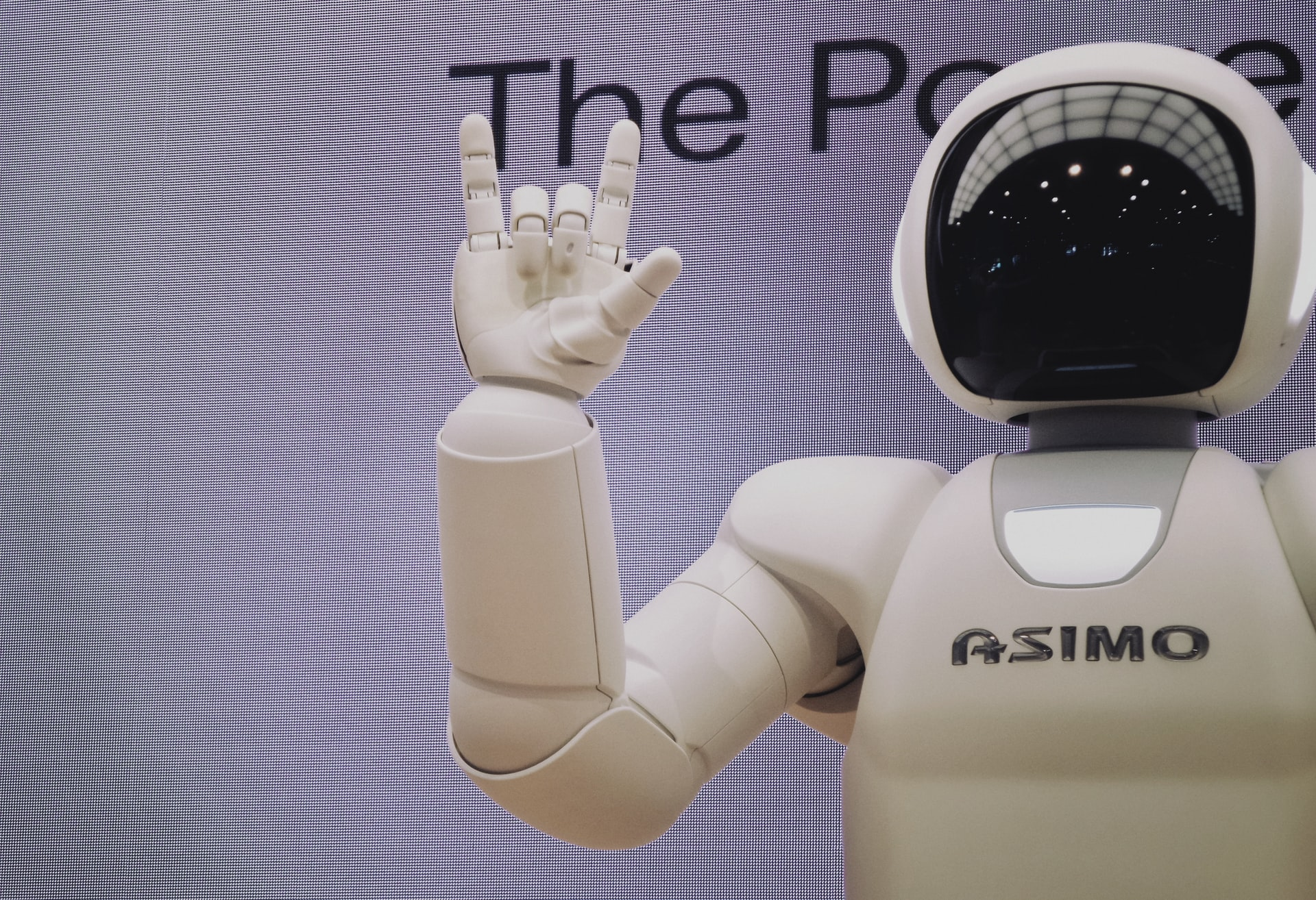 """future robot asimo holding up """"love"""" in ASL"""